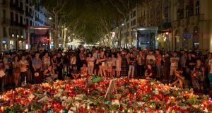 Mourners gather at Las Ramblas,  in Barcelona, Spain. Photograph: Samuel Aranda/The New York Times