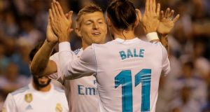 Real Madrid's Toni Kroos celebrates scoring their third goal with Gareth Bale. Photograph: Reuters