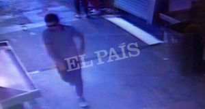 CCTV frame grab shows a suspect walking through La Boqueria market seconds after a van crashed into pedestrians in Barcelona on August 17th. Photograph: Courtesy of El Pais via Reuters .