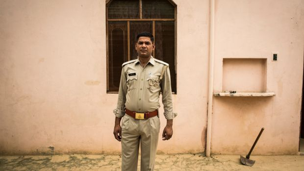The policeman: Jahangir Khan, a constable who initially propagated the official version of events that labelled a village wife's murder an accident, in Peepli Khera, India. Photograph: Andrea Bruce/New York Times