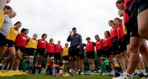 Ireland Women's head coach Tom Tierney talks to his players during a training session in Belfast. Photograph: Dan Sheridan/Inpho