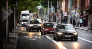 Vehicles keep to one lane on the first day of  new traffic arrangements on  the Quays at Bachelors Walk, Dublin. Photograph: Dara Mac Dónaill/The Irish Times