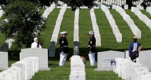 US Marines stand at attention during an interment ceremony in Arlington National Cemetery's Section 60, which contains the graves of many members of the US  military killed in   Afghanistan. Photograph: Joshua Roberts/Reuters