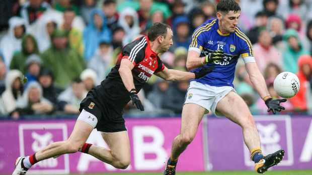 Mayo's Keith Higgins trying to keep tabs on Kerry's Paul Geaney. Photograph: Gary Carr/Inpho