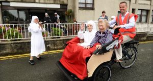 TAKE THE WHEELS: Sr Mary Colomban, Frances Neary and Fergus Cooney ride on a trishaw donated to Sybil Hill Nursing Home by Canada Life, in Dublin. Photograph: Cyril Byrne/The Irish Times