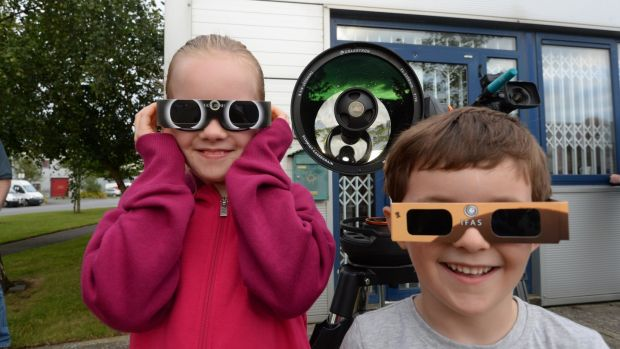 Eva and Flinn Bracken, from Swords, at Astronomy Ireland headquarters in Blanchardstown for the partial solar eclipse. Photograph: Cyril Byrne/The Irish Times