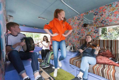 AG DAMHSA: Katie Reilly dances in the 'Céilí Caravan' at the Fleadh Cheoil na hÉireann, in Ennis, Co Clare. Photograph: Eamon Ward