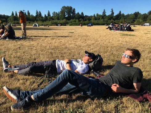SOLAR ECLIPSE: Jonathan Moric and Finn Power get ready to watch the solar eclipse, in a park in Salem, Oregon, US. Photograph: Andrew Selsky/AP Photo
