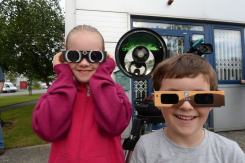 SOLAR ECLIPSE: Eva and Flinn Bracken at Astronomy Ireland's headquarters in Blanchardstown, Co Dublin, for the partial solar eclipse. Photograph: Cyril Byrne/The Irish Times