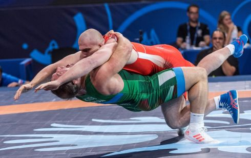 GRAPPLING HOOK: Balázs Kiss of Hungary and Musa Yevloyev of Russia fight in the Wrestling World Championships, in Paris, France. Photograph: Zsolt Szigetvary/EPA