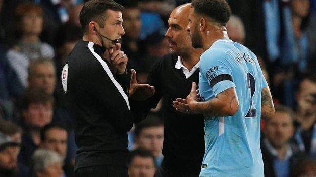 Pep Guardiola and Kyle Walker protest the fullback's sending off aginast Everton. Photograph: Phil Noble/Reuters