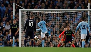 Raheem Sterling scores Manchester City's late equaliser aganist Everton. Photograph: Phil Noble/Reuters