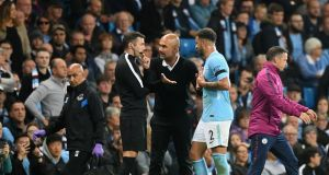 Pep Guardiola and Kyle Walker remonstrate with fourth official Michael Oliver after the fullback's sending off. Photograph: Michael Regan/Getty