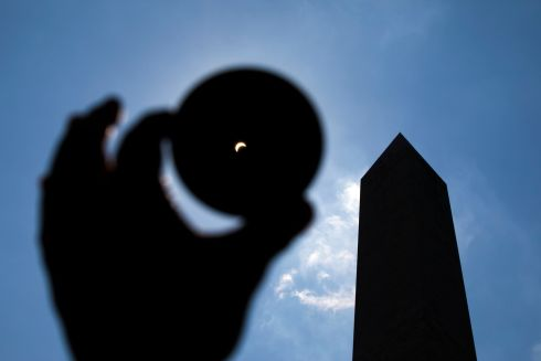 epa06155391 The moon eclipses the sun near the Washington Monument during the so-called 'Great American Eclipse' in Washington, DC, USA, 21 August 2017. Eighty one percent of the sun was obscured in DC; the thin path of totality, where viewers were treated to a total eclipse, passed through portions of 14 US states, according to the National Aeronautics and Space Administration (NASA).  EPA/JIM LO SCALZO