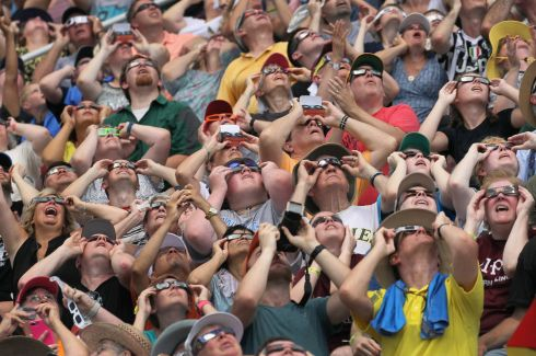 CARBONDALE, IL - AUGUST 21:  People watch the solar eclipse at Saluki Stadium on the campus of Southern Illinois University on August 21, 2017 in Carbondale, Illinois. Although much of it was covered by a cloud, with approximately 2 minutes 40 seconds of totality the area in Southern Illinois experienced the longest duration of totality during the eclipse. Millions of people are expected to watch as the eclipse cuts a path of totality 70 miles wide across the United States from Oregon to South Carolina on August 21.  (Photo by Scott Olson/Getty Images)