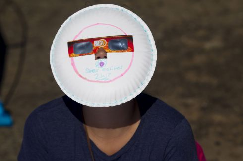 "MENAN, ID - AUGUST 21: Locals and travelers from around the world gather on Menan Butte to watch the eclipse on August 21, 2017 in Menan, Idaho. Millions of people have flocked to areas of the U.S. that are in the ""path of totality"" in order to experience a total solar eclipse. (Photo by Natalie Behring/Getty Images)"