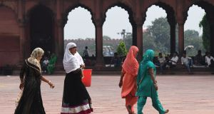 Indian Muslim women visiting the Jama Masjid mosque in New Delhi on Tuesday, as the supreme court banned   a controversial Islamic practice that allows men to divorce their wives instantly. Photograph: Prakash Singh/AFP/Getty Images