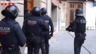 Barcelona attack: police release footage of raids on suspects's homes