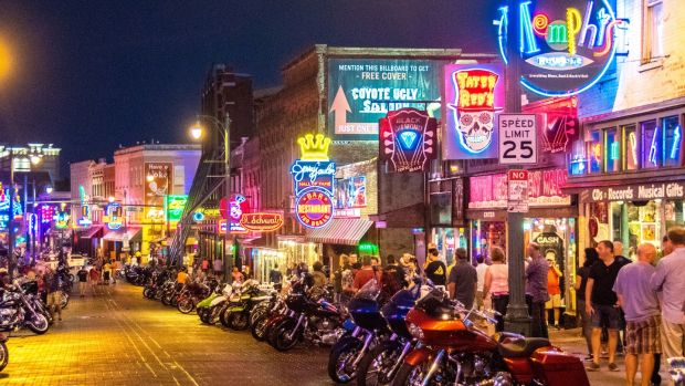 Memphis, Tennessee: Beale Street at night with local bars and clubs, and motorcycles lining the streets