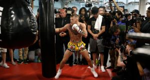 Conor McGregor performs a workout in front of the media in preparation for the fight against Floyd Mayweather Jr in Las Vegas. Photograph: John Locher/AP