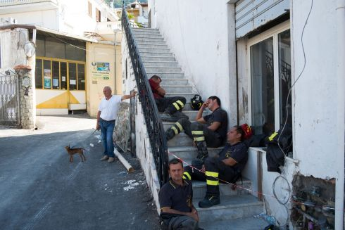 QUAKE COLLAPSE: Rescuers rest on steps in Casamicciola Terme, on the Italian island of Ischia, after an earthquake hit the popular tourism location off the coast of Naples, causing buildings to collapse overnight and leaving two dead. Photograph: Eliano Imperato/AFP/Getty Images