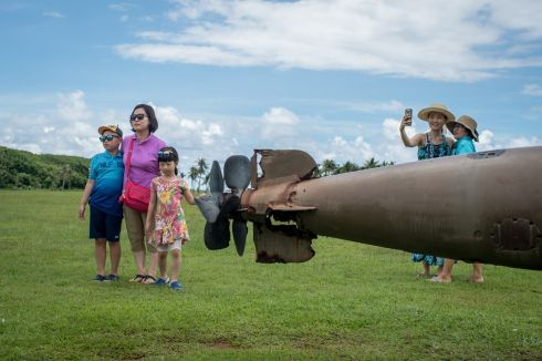 USED TO THREATS: Korean tourists observe a torpedo at Asan Beach in Guam, where US soldiers made their landing during the second World War. Japanese and South Korean visitors who are vital to Guam's tourism industry are long accustomed to threats from North Korea, and therefore unlikely to stay away from the US Pacific territory. Photograph: Nancy Borowick/New York Times