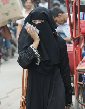 "DIVORCE DECLARATION: A muslim woman in the old Delhi city area, New Delhi, India, August 22nd, 2017. India's Supreme Court on this date declared unconstitutional the Muslim practice of ""triple talaq"", where a husband can end a marriage unilaterally and instantly by repeating the word ""talaq"", meaning ""divorce"", three times. Photograph: EPA"