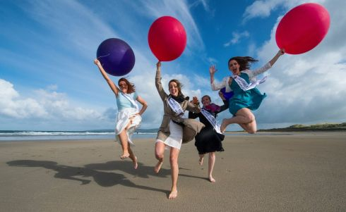 Rose of Tralee International Festival. Clare rose, Aoife Murray, Toronto rose Colombe Nadeau-O'Shea, Hong Kong rose, Clarissa Langley Coleman and West Meath rose Eve Cooney flying high on the beach at Banna, Co Kerry. Photo By Domnick Walsh Eye Focus