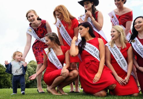 10 month old Lily Callaghan, from Malahide, gate crashes a photocall, on the grounds of Malahide Castle, Dublin, to introduce the 65 International Roses hoping to make it through to the 2017 International Rose Television Selections. Photo: Brian Lawless/PA Wire