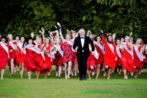 Presenter  Dáithí Ó Sé with Contestants in the Rose of Tralee during  a  photo call at Malahide Castle. . Photograph: Cyril Byrne / THE IRISH TIMES