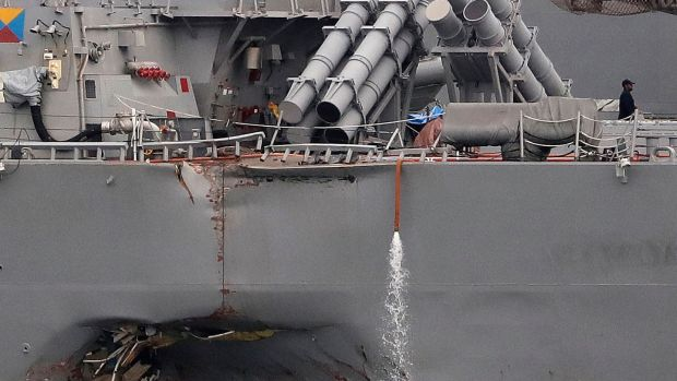 The damaged port aft hull of the USS John S McCain, as the vessel is docked at Singapore's Changi naval base. Photograph: Wong Maye-E/AP