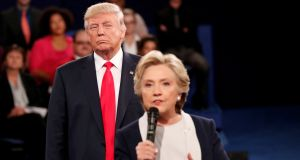 Republican US presidential nominee Donald Trump stands behind Democratic rival Hillary Clinton as she answers a question from the audience during their presidential town hall debate in St Louis, Missouri, last October. Photograph: Rick Wilking/Reuters