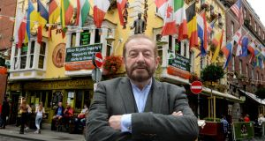 Martin Keane outside the Oliver St John Gogarty in Temple Bar, probably Dublin's most profitable – and expensive – pub, with a pint of Heineken costing €8. Photograph: Cyril Byrne