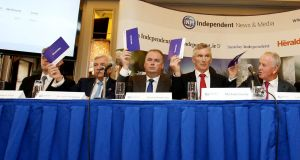 INM chief executive Robert Pitt  (far left, obscured) fails to vote for Leslie Buckley (far right) as chairman of INM at the company's AGM in Dublin. Photograph: Sam Boal/Rollingnews.ie