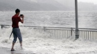 Wave caused by Typhoon Hato sweeps pedestrians off their feet