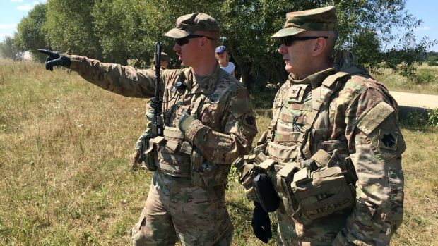 Dave Jordan (right), commander of the 45th infantry brigade of the Oklahoma national guard that is now in western Ukraine training the country's soldiers, oversees drills with Lieut Travis Shuck. Photograph: Daniel McLaughlin