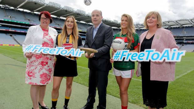 Minister for Communications, Denis Naughten with president of the Camogie Association, Catherine Neary, Kilkenny's Miriam Fribsy, Mayo's Sarah Rowe and Ladies Gaelic Football Association President, Marie Hickey at Croke Park in Dublin Wednesday where he announce that he has designated the All-Ireland Senior Ladies Gaelic Football and Camogie Final as 'events of major importance to society'. Photograph: Maxwell's
