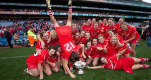 Cork celebrate with the O'Duffy Cup after their victory in 2015. The All-Ireland camogie final has been designated free to air. Photograph: Ryan Byrne/Inpho