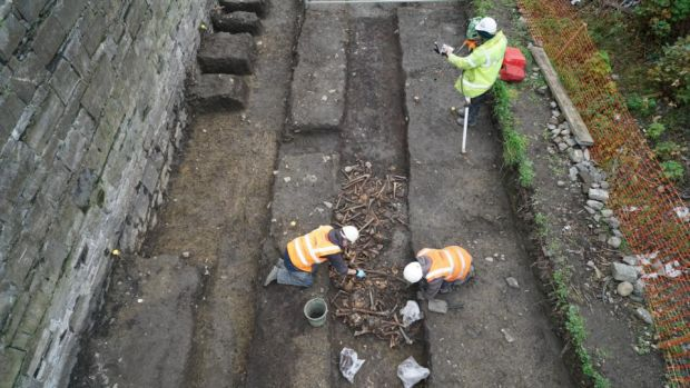 Luas Cross City archaeologists uncover the skeletons of up to 1,700 cholera victims buried in two trench graves near Grangegorman, in 2015.