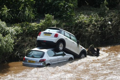NORTHWEST STORMS: A view of cars that were washed into the river Faughan in Drumahoe, Derry, after heavy rain in the area. Photograph: Niall Carson/PA Wire