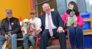 Minister Michael Ring with Aisling Maguire (11) from Ardee, Co Louth, with her dogs Millie  and Fudge, and Coleen O'Neill (14) from Newtownbutler, Co Fermanagh, with her dog Missy at the   show. Photograph: Lorraine Teevan