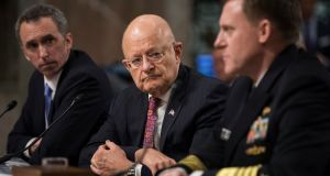 Former US  director of national intelligence James Clapper  (centre) has joined a growing chorus of alarm over president Trump's erratic behaviour. Photograph: JimLo Scalzo