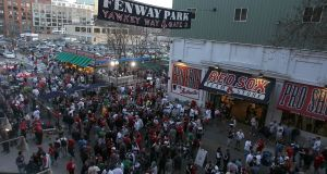 Fans enter Yawkey Way before a game between the Boston Red Sox and the New York Yankees. Photograph: Jim Rogash/Getty Images