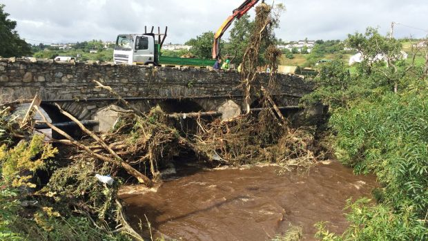 The clean-up which got under way at Cockhill Bridge in Buncrana, Co Donegal. Photograph: Brian Hutton/PA Wire