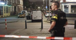 Police in Rotterdam investigate a van with Spanish number plate packed with gas canisters in the vicinity of the concert venue Maassilo, after a concert was cancelled because of a terrorist threat. Photograph: Arie Kievit/EPA