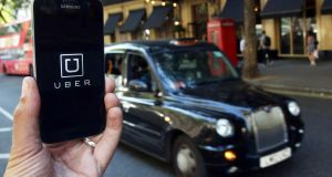 Uber said its gross ride bookings for the second quarter reached $8.7 billion, up from $7.5 billion in the first quarter. Photograph: Neil Hall/Reuters