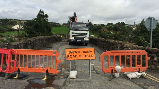Clean up operations under way at Cockhill Bridge in Buncrana, Co Donegal. Photograph: Brian Hutton/PA Wire