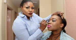 Yetunde Awosanya from Nigeria working on make up for Siphiwe Sandra Moyo. Photograph: Cyril Byrne