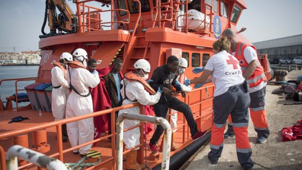 A migrant is helped by Red Cross volunteers to disembark after 143 Moroccans and nine sub-Saharans were rescued in the waters of the Strait of Gibraltar in June. Photograph: Marcos Moreno/AFP/Getty Images