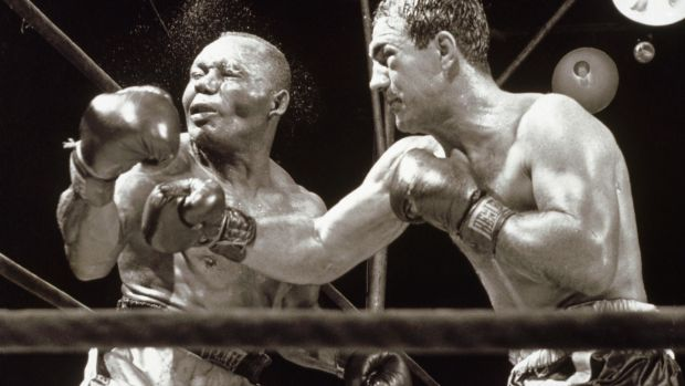 Mayweather is looking to beat Rocky Marciano's record of 49 fights and 49 wins. Marciano is pictured knocking out Jersey Joe Walcott in 1952. Photo: Getty Images